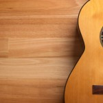 Acoustic guitar with wood background and copy space